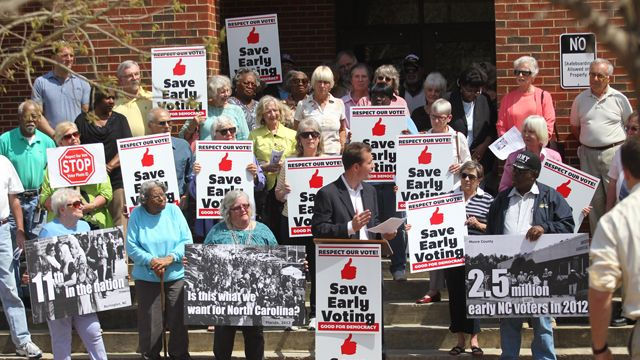 Gerrick Brenner of Progress NC was joined by Save Early Voting supporters on the steps of the Craven County Administration Building, New Bern, N.C., Tuesday, April 9, 2013 while addressing the media. (AP Photo/Sun Journal, Chuck Beckley)