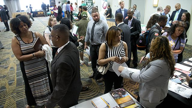 In this June 23, 2014 photo, job seekers and recruiters meet during a job fair in Philadelphia. The Labor Department releases weekly jobless claims on Thursday, June 26, 2014. (AP Photo/Matt Rourke)