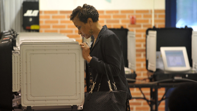 A woman votes at Woodridge Elementary School in Stone Mountain, Ga., on Tuesday, May 20, 2014. Five major GOP candidates will square off to represent their party this fall in the election to replace retiring U.S. Sen. Saxby Chambliss. Meanwhile, Michelle Nunn, daughter of former U.S. Sen. Sam Nunn is a heavy favorite to win the Democratic nomination. (AP Photo/Atlanta Journal-Constitution, Kent D. Johnson)