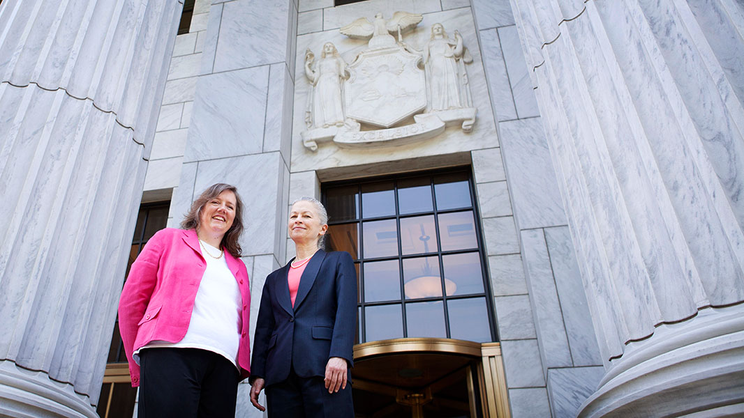 Helen Slottje and Deborah Goldberg stand on the steps of the Court of Appeals in Albany on June 3, 2014, shortly before oral arguments. (Photo: Chris Jordan-Bloch/Earthjustice)