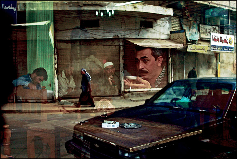 Six weeks before the start of the war, a man sits drinking tea at the Al Zahawi cafe on Rashid Street. Baghdad February 12, 2003. Photo by Bruno Stevens