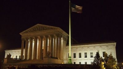 The Supreme Court Building at night. (Image: Wikimedia Commons/ Slowking)