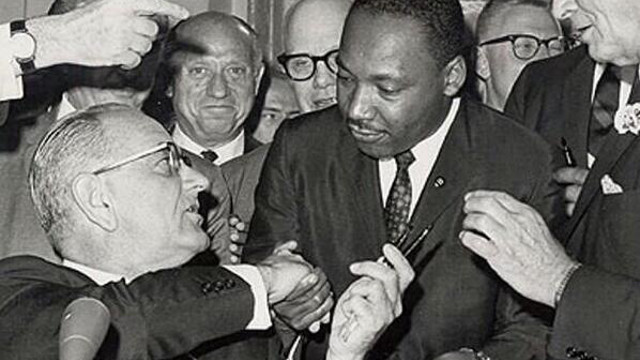 President Lyndon Johnson gives Rev. Martin Luther King Jr. a pen used to sign the Civil Rights Act on July 2, 1964. (Image: Library of Congress)