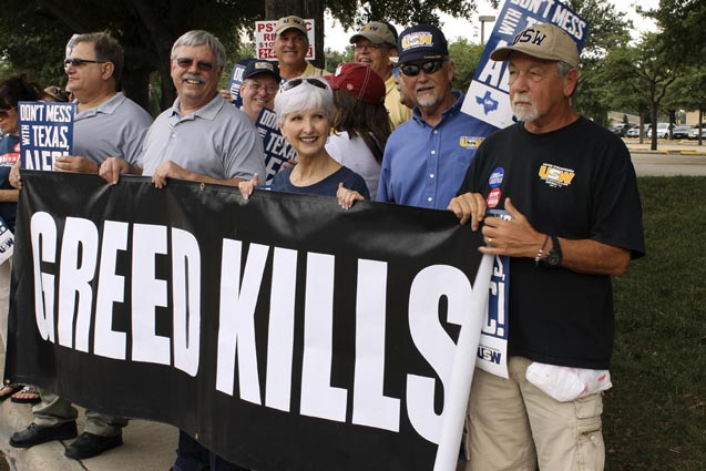 Organizers greet ALEC attendees during a rally outside the Hilton Anatole Wednesday, July 30, 2014. (Photo: Candice Bernd)