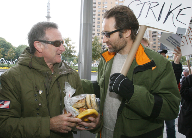 Actor David Duchovny, right, talks with fellow actor Robin Williams as Williams arrives to join the picket line along with Duchovny and others during the fourth day of a strike by television and film writers, Thursday, Nov. 8, 2007 at the Time Warner Center in New York. (AP Photo/Tina Fineberg)