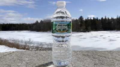 A bottle of Poland Spring water rests on a granite slab in East Derry, N.H., Tuesday, March 5, 2013. (AP Photo/Charles Krupa)