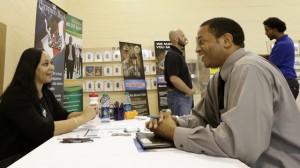 Job seeker US Air Force veteran Jesse Jefferson, Jr., right, talks to Arianna Alexander, of the Pompano Beach Veterans Center, at a Hiring Fair For Veterans in Fort Lauderdale, Florida. (AP Photo/Alan Diaz)