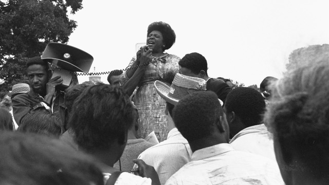 Mrs. Fannie Lou Hamer of Ruleville, MS, speaks to Mississippi Freedom Democratic Party sympathizers outside the Capitol in Washington, DC, September 17, 1965, after the House of Representatives rejected a challenge to the 1964 election of five Mississippi representatives.  (Photo by William J. Smith/AP)