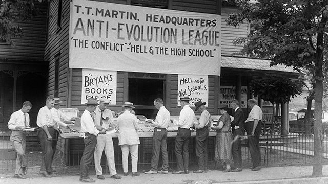 Evangelist T.T. Martin's books against the theory of evolution are sold at an outdoor stand in Dayton, Tenn., 1925, scene of the Scopes trial. (AP Photo)