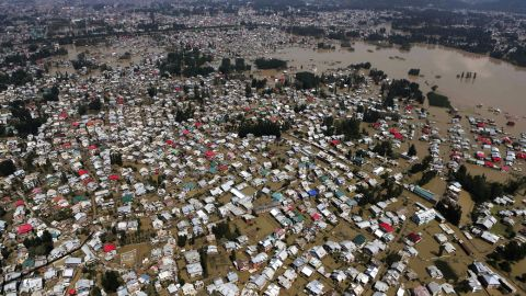 An aerial view showing buildings partially submerged in Srinagar, Indian-controlled Kashmir, Wednesday, Sept.10, 2014. Raging monsoon floods sweeping across India and Pakistan have killed more than 440 people, authorities said Tuesday, warning hundreds of thousands more to be prepared to flee their homes as helicopters and boats raced to save marooned victims.(AP Photo/Dar Yasin)