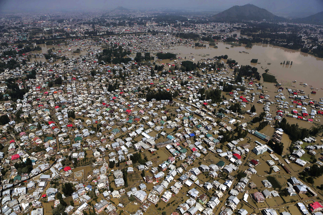 An aerial view showing buildings partially submerged in Srinagar, Indian-controlled Kashmir on Sept. 10, 2014. Raging monsoon floods sweeping across India and Pakistan have killed more than 440 people, authorities said Tuesday, warning hundreds of thousands more to be prepared to flee their homes as helicopters and boats raced to save marooned victims.(AP Photo/Dar Yasin)