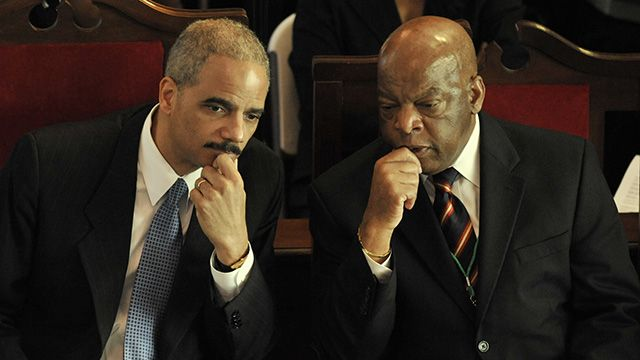 United States Attorney General Eric Holder, left, with Congressman John Lewis, (D-GA) attended the 44th anniversary of the Voting Rights March at the Brown AME Chapel in Selma, Alabama in 2009. (AP Photo/ Kevin Glackmeyer)
