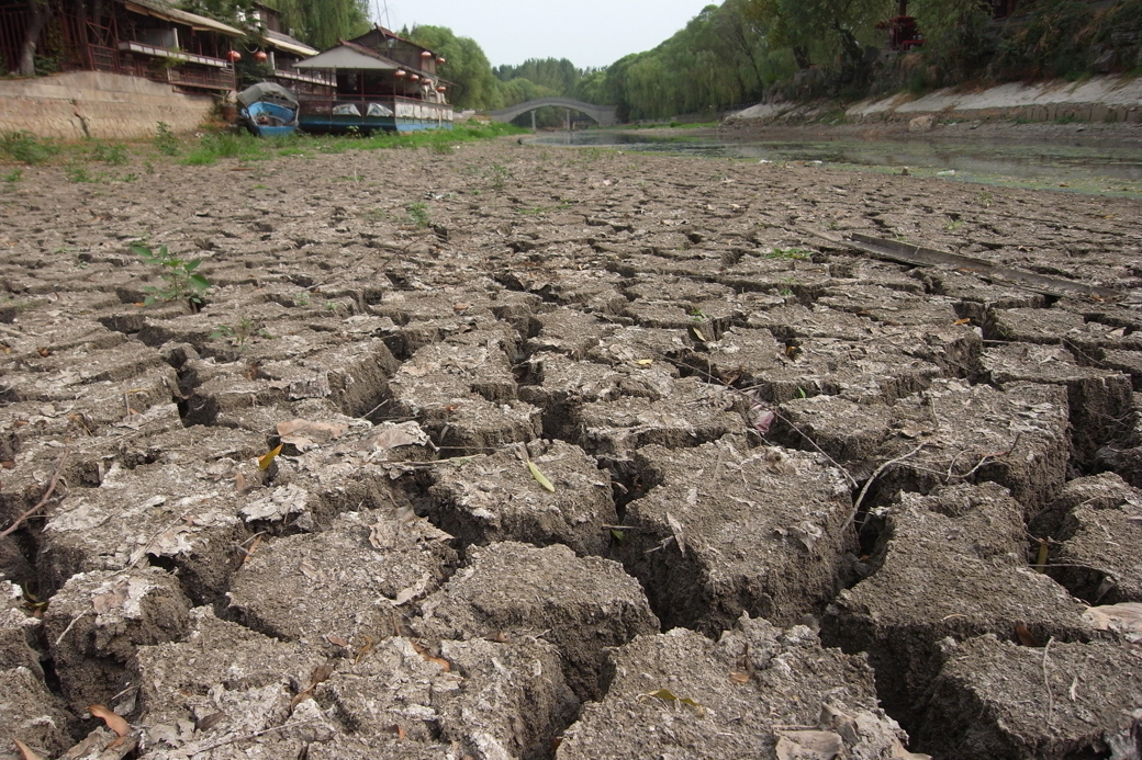 View of the cracked bed of the nearly dried-up Qingni River during a drought in Xuchang city, central Chinas Henan province on July 29, 2014. The worst drought since 1951 hit central Chinas Henan province. About 245,000 people face shortages of drinking water, while 1.54 million hectares of grain due to be harvested in the autumn are suffering from the drought. More than half of Henan is suffering serious problems with 20 percent of the land area rated extremely dry. More than 50 percent of the provinces small to medium rivers and 35 percent of its small reservoirs have dried up.