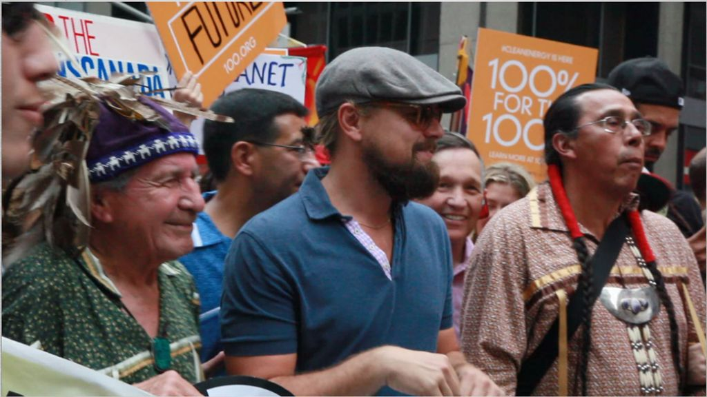 Leonardo DiCaprio and, over his left shoulder, Ohio politician and former candidate for president Dennis Kucinich. (Photo: Sikay Tang)