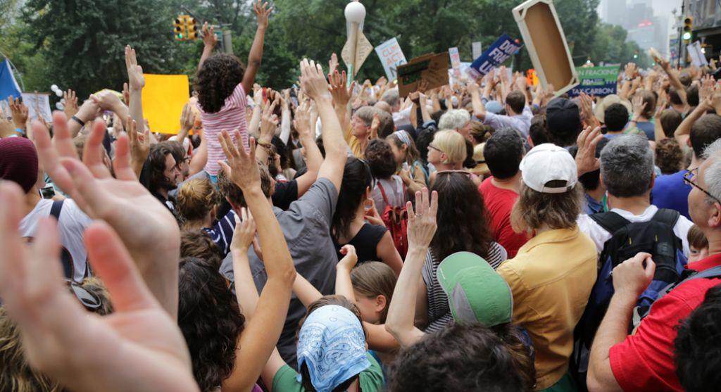 """A crowd of demonstrators at 72nd street """"sounds the alarm"""" on climate change. (Photo: John Light)"""