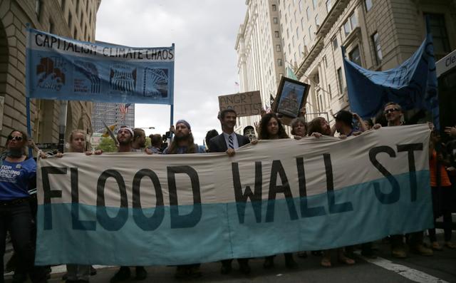 The demonstrators march up Broadway toward Wall Street. (Photo: John Light)
