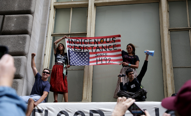 Representatives of a larger contingent of North American indigenous peoples protest at the Flood Wall Street protest. (Photo: John Light)