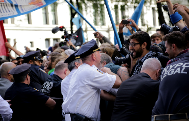 New York Police officers and protestors clash at the intersection of Broadway and Wall Street at the Flood Wall Street protest. (Photo: John Light)