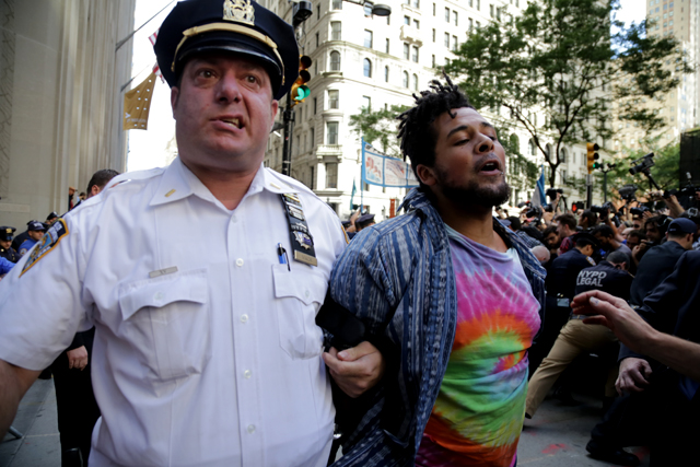 A protestor is arrested at the Flood Wall Street protest. (Photo: John Light)
