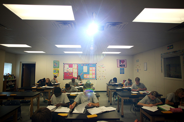In many states, the battle over charters is largely between those who believe in regulating them and those who believe that's the job of the free market. An eighth-grade class at Columbus Charter School is above. (Travis Dove for ProPublica)