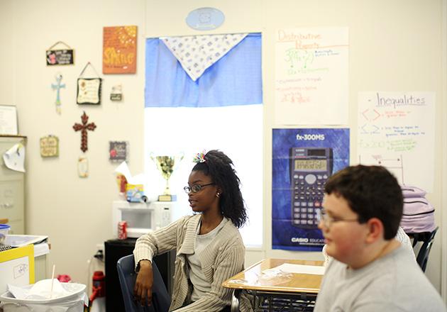 Sixth-grade students conduct a mock job interview at Columbus Charter School. (Travis Dove for ProPublica)