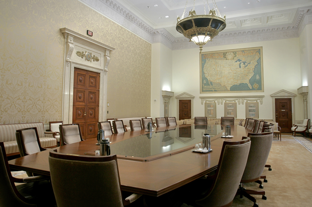 A 1,000-pound brass and glass chandelier festooned with eagles hangs from the 23-foot-high ceiling above the table in the meeting room of the Board of Governors of the Federal Reserve System, usually known as the Fed, in this Tuesday, Jan. 25, 2005 photo. (AP Photo/Lawrence Jackson)