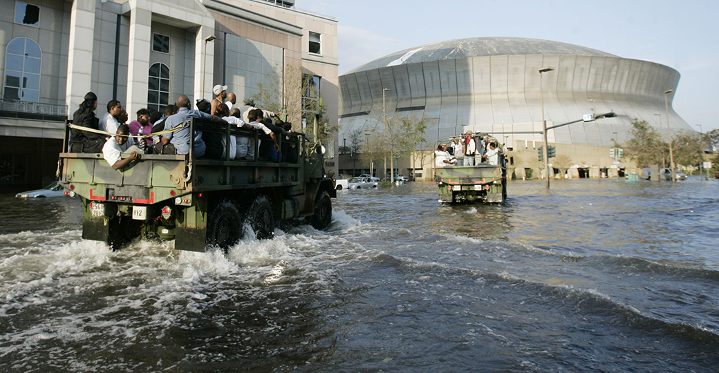 National Guard trucks haul residents through flood waters to the Superdome, a shelter of last resort,  after their neighborhoods were flooded after Hurricane Katrina hit  New Orleans, Louisiana Tuesday, August 30,  2005.  (AP Photo/Eric Gay)