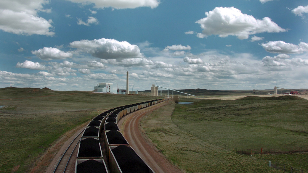In this Thursday, April 29, 2010 photo, a pair of coal trains idle on the tracks near Dry Fork Station, a coal-fired power plant. (AP Photo/Matthew Brown)