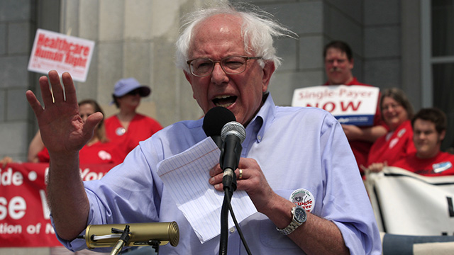 Senator Bernie Sanders, I-Vt., speaks to a crowd of several hundred people during a health care rally in front of the Statehouse in Montpelier, Vt., Saturday, May 1, 2010, where single-payer health care system supporters gathered believing that the federal bill didn't go far enough.(AP Photo/Alden Pellett)