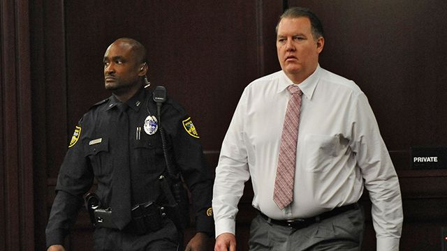 Defendant Michael Dunn re-enters the courtroom as the jury had a question shortly after deliberations began during his retrial on Wednesday, Oct. 1, 2014 in Jacksonville, Fla. Dunn is being retried on murder charges for the shooting death of 17-year old Jordan Davis in a dispute over loud music at a Jacksonville gas station in November of 2012. Dunn was found guilty of three counts of attempted murder and one count of shooting or throwing a deadly missile during his previous trial, but the jury was deadlocked on the murder charge. (AP Photo/The Florida Times-Union, Bob Mack, Pool)