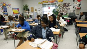 Clarksdale High School students delve into the complexities of chemistry equations, in Clarksdale, Miss. Community leaders hope improved education will help stanch a hemorrhaging population. The city's nine public schools may also be the crossroads of Mississippi's education system as state lawmakers are considering a new route, one characterized by charter schools, teacher merit pay, a tougher statewide curriculum, state-paid preschool classes and an intensive focus on reading for young students. (AP Photo/Rogelio V. Solis)