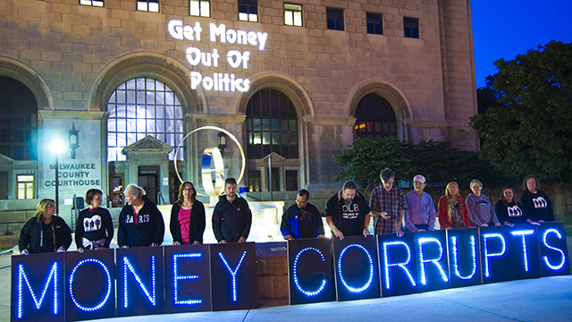 A demonstration earlier this year outside the Milwaukee County Courthouse. The Move to Amend ballot question passed in Milwaukee County on Tuesday with 70 percent of the vote. (Photo by Light Brigading/flickr CC 2.0)