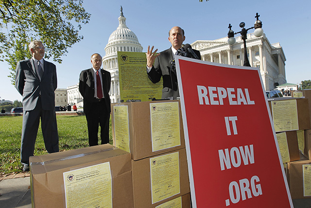 """Rep. Louie Gohmert, R-Texas, right, joins critics of President Obama's national heath care plan, often called """"Obamacare,"""" to advocate for repeal of the legislation, Wednesday, Oct. 5, 2011, during a news conference on Capitol Hill in Washington. (AP Photo/J. Scott Applewhite)"""