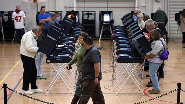 People cast their ballots in Carson City, Nevada, on Tuesday, Nov. 4, 2014. (Photo by Cathleen Allison/AP)