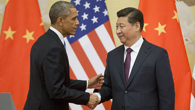 US President Barack Obama, left, and Chinese President Xi Jinping shake hands following the conclusion of their joint news conference at the Great Hall of the People in Beijing on Nov. 12, 2014. (AP Photo/Pablo Martinez Monsivais)