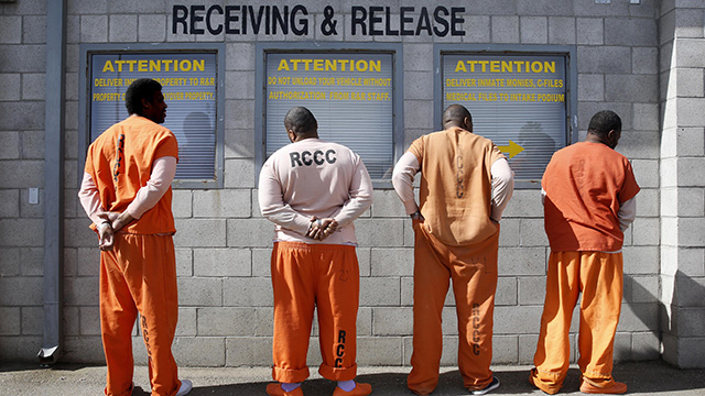 Taken Thursday, Feb. 20, 2014, prisoners from Sacramento County await processing after arriving at the Deuel Vocational Institution in Tracy, California. (AP Photo/Rich Pedroncelli)