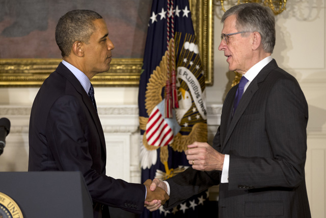 In this May 1, 2013 file photo, President Barack Obama shakes hands with then nominee for Federal Communications Commission, Tom Wheeler, in the State Dining Room of the White House in Washington.  (AP Photo/Jacquelyn Martin, File)
