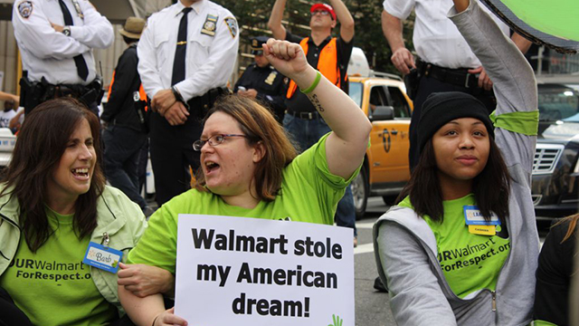 Wal-Mart workers protesting for better wages and a union in front of Alice Walton's $25 million Park Ave penthouse in NYC on October 16, 2014. (Photo: Charina Nadura/Moyers & Company)