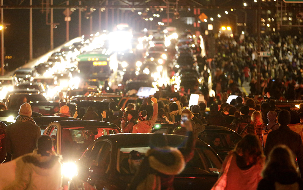 Vehicles are gridlocked on the West Side Highway by a crowd of protesters after it was announced that the New York City police officer involved in the death of Eric Garner was not indicted, Wednesday, Dec. 3, 2014, in New York.  (AP Photo/Julio Cortez)