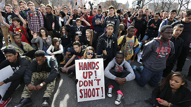 On December 3rd, 2014, East High School students in Denver participate in a protest  In front of the state Capitol, against the Ferguson, Missouri grand jury decision not to indict Darren Wilson  for the killing of MIchael Brown.Dec. 3, 2014. (AP Photo/Brennan Linsley)
