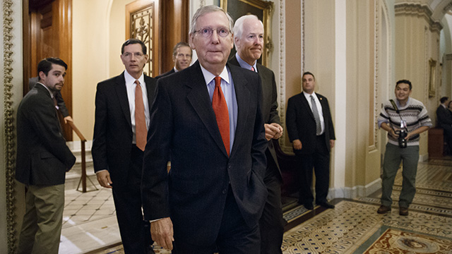 Senate Minority Leader Mitch McConnell of Kentucky arrives to speak with reporters following a closed-door policy meeting on Capitol Hill in Washington, Tuesday, Dec. 2, 2014.  (AP Photo/J. Scott Applewhite)