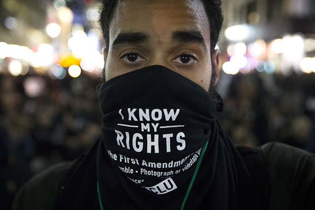 Protestors occupy Herald Square during march Thursday, Dec. 4, 2014, in New York, against a grand jury's decision not to indict the police officer involved in the death of Eric Garner.  (AP Photo/John Minchillo)