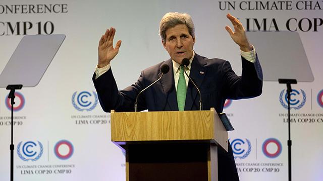 US Secretary of State John Kerry addresses the UN Climate Change Conference in Lima, Peru on Dec. 11, 2014.  (AP Photo/Rodrigo Abd)