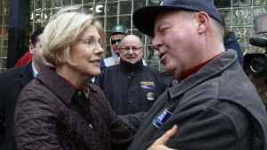 Massachusetts Senator-elect Elizabeth Warren (D-MA) is congratulated by Mark Walsh of Boston as she greets commuters and thanks Massachusetts residents, Wednesday, Nov. 7, 2012, in Boston. Warren defeated incumbent Republican Sen. Scott Brown. (AP Photo/Bizuayehu Tesfaye)