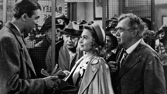"""James Stewart, left, Thomas Mitchell, right, and Donna Reed appear in the 1946 movie """"It's A Wonderful Life."""" (AP photo)"""