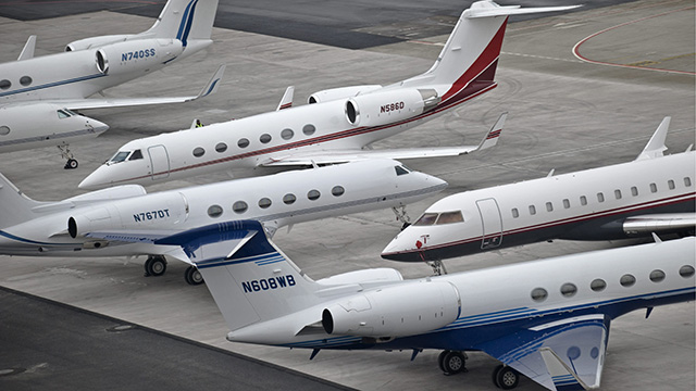 Private jets of participants from the Annual Meeting of the World Economic Forum, WEF, in Davos stand at the airport in Kloten near Zuerich, Switzerland, Wednesday, Jan. 28, 2009. The overarching theme of the World Economic Forum, WEF, annual meeting which will take place from Jan. 28  to Feb. 1, is 'Shaping the Post-Crisis World'. (AP Photo/Keystone/Urs Jaudas)