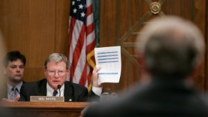 Sen. James Inhofe, ranking Republican on the Senate Environment and Public Works Committee, holds up a document while questioning former Vice President Al Gore during the committee's hearing on global climate change on March 21, 2007, on Capitol Hill in Washington. (AP Photo/Susan Walsh)