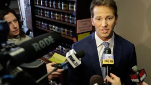 Rep. Aaron Schock speaks to reporters before meetings with constituents after a week in which he faced twin scandals Friday, Feb. 6, 2015, in Peoria, Illinois. (AP Photo/Seth Perlman)