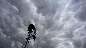 Dark storm clouds hover over rural farmland just north of Walla Walla, Wash. on Wednesday, Dec. 10, 2014. (AP Photo, Walla Walla Union-Bulletin, Greg Lehman)