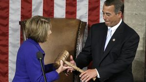 This Jan. 5, 2011 photo shows then-outgoing House Speaker Nancy Pelosi handing the gavel to the new House Speaker John Boehner during the first session of the 112th Congress on Capitol Hill in Washington, DC. (AP Photo/Charles Dharapak, File)